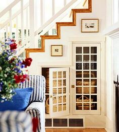Possible way to open up dark rooms and keep under stair storage. It just depends on how structurally important the walls are!!