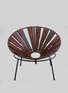 Bowl chair in leather designed by Lina Bo Bardi in the 1950s