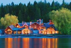 Love this private estate on the water.   Especially, the lit from within glow that comes from this home...
