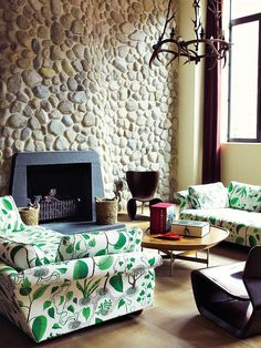 Designer - Marc Newson. Love the sofas!