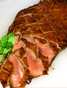 Kentucky Derby Flank Steak! A Bourbon and brown sugar marinade plus mint are a wonderful flavor combination for this grilled steak. #smarterbeef