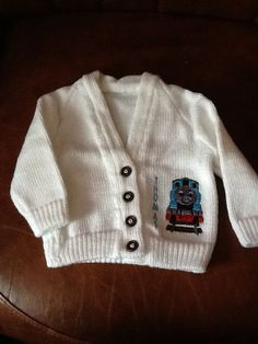 Hand knitted baby cardigan with Thomas the by Happilyevercrafts, Knitted Baby Cardigan, Thomas The Tank, Knit Patterns, Colouring, Baby Knitting, Handmade Gifts, All Things, Engine, Knit Crochet