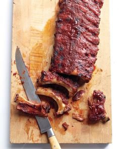 Smoky Baby Back Ribs Smoky, sticky, falling-off-the-bone ribs are easier than you think. Just cook them long and slow -- on the grill or in the oven. Tailgating Recipes, Grilling Recipes, Cooking Recipes, Football Recipes, Rib Recipes, Great Recipes, Favorite Recipes, Delicious Recipes, Recipe Ideas