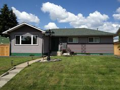 Exterior repaint in Green Zebra (CL2077N), Cobblestone (CL2483M) on the stucco and Outback (CL2486A) for the wood siding.