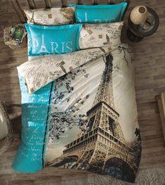 Pra quem ama viajar, esse edredom com tema da torre Eiffel e de Paris é um prato cheio na decor do quarto!