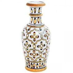 Make your living space and office look fantastic with this glamorous flower vase. Crafted in pure white marble, it is embellished with Meenakari and kundan work that is complemented by expert enamel work. Aesthetically designed Marble Flower Vase has been hand painted with gold paint with touches of Red color for a graceful look. Each vase is diligently handcrafted by skilled artisans using various traditional techniques.