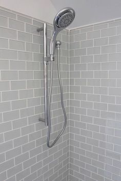 Nice gray shower tile with Moen Shower Faucet http