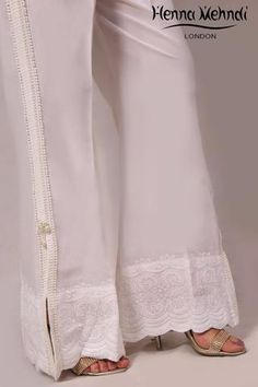 White cotton trousers with lace and pearl embellishment on side. Please note these are trousers only. Please note delivery time is approximately weeks. Pakistani Couture, Pakistani Dress Design, Fashion Pants, Fashion Dresses, Pants For Women, Clothes For Women, Women Trousers, Trouser Pants, Kurtis With Pants
