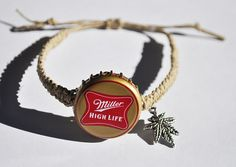 This bracelet was hand-crafted using a recycled Miller High Life beer cap, 1 mm wide natural hemp, and red acrylic pony beads. The beer cap was coated with clear acrylic spray to hinder rusting. The bracelet is fully adjustable in size with a sliding knot. Thanks for taking a look! Please see my other listings for other beer cap designs.  DISCLAIMER: This is not a licensed Miller High Life product. It is however, hand-crafted from a recycled Miller High Life bottle beer cap. I am not…