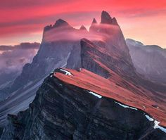 The Red Barrier in Dolomites, Italy. Photo by @maxrivephotography