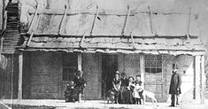 Ellen Kelly's release from prison in February 1881 is commemorated by this photo taken at the Kelly homestead. It shows from left, Alice King, Kate Kelly, Grace Kelly (with Faith, the Kelly cattle dog), Mrs Kelly, Jack King, Ellen King (feeding a pet lamb from a bottle) and the Rev. William Gould who had married Ellen Kelly and George King seven years earlier. Scarcely more than two months later, Constable Robert Graham visited here with Father Thomas Egan of Wangaratta and gained Mrs…