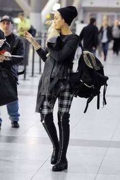 Take it from Miley: Grunge is the way to go while traveling. Her plaid leggings and boyish beanie are comfortable yet still undeniably chic.   - ELLE.com