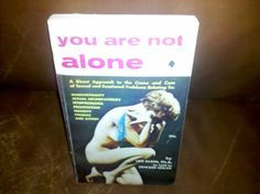 YOU ARE NOT ALONE, CB109 by LEO KLEINE, PH.D. AS TOLD BY EDWARD UHLAN  U.S.A.: CHARIOT BOOKS, INC., 1959 A DIRECT APPROACH TO THE CAUSE AND CURE OF SEXUAL AND EMOTIONAL PROBLEMS RELATING TO: HOMOSEXUALITY, SEXUAL INCOMPATIBILITY, NYMPHOMANIA, PROSTITUTION, FRIGIDITY, MASTURBATION, IMPOTENCE PHOBIAS AND OTHERS. ADS OF BOOKS I...  more   Offered By  Eagle Spirit Books