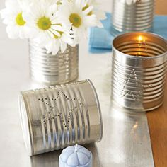 I love these simple DIY star can votive holders. They would make a great addition to your Oscars party decor. They're not hard to make either.  Simply rinse out a few same-size cans, peel off the labels and poke a star pattern into them with a paper piercer. #CouchCritics