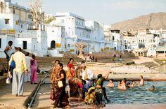 India, Pushkar. People taking bath in water of the holy lake in Pushkar.