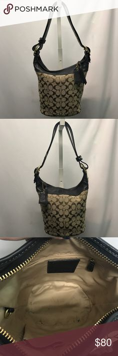 """COACH purse Brown cloth """"C"""" printed Coach purse with brown leather accent and gold hardware. Beautiful bucket shape, spacious inside with one zipper pocket and two open pockets. Beautiful condition Coach Bags"""