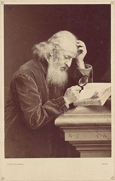 [Bearded Man with Magnifying Glass Examining a Manuscript] 1870's.                                             Antoine-Samuel Adam-Salomon