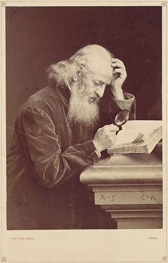[Bearded Man with Magnifying Glass Examining a Manuscript] 1870's.                                             Antoine-Samuel Adam-Salomon