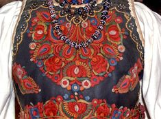 Traditional Hungarian jewelry and embroidery brightly adorn this leather vest from Transylvania (Romania). Photo by Ágnes Fülemile, Balassi Institute/Hungarian Cultural Center Hungarian Embroidery, Folk Embroidery, Embroidery Patterns, Floral Embroidery, Folk Fashion, Fashion Art, Etnic Pattern, Costumes Around The World, Embroidery For Beginners