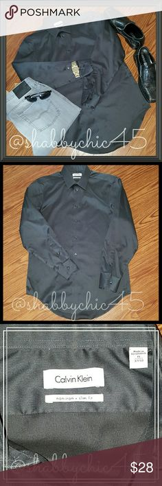 Calvin Klein No Iron Slim Fit Dress Shirt EUC EUC Calvin Klein Men's Charcoal Dress Shirt. No Iron-Slim Fit. Awesome deal! Trendy and versatile! This shirt goes great with slacks and a tie for the  office and them sport your favorite pair of jeans for happy hour after work! Great neutral color goes great with anything! Shirt is in like new condition!! Size is 15/32-33.   💘Smoke free home. No trades. Open to reasonable offers unless marked as firm. Happy Poshing!! 💘 Calvin Klein Shirts…