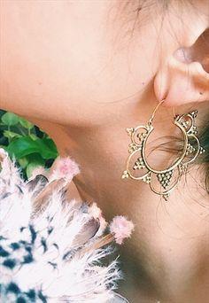Brass hoop earrings.