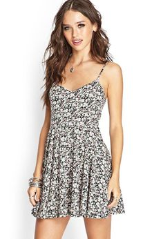 Style Deals - This knit skater dress features an allover floral print and  adjustable shoulder str 222382849