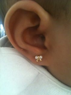 Nowadays it's common to see a baby with earrings. But, how often do you see an infant with a nose ring? One anonymous mom admitted to piercing her baby'… Baby Earrings, Girls Earrings, Cute Earrings, Baby Jewelry, Gold Jewelry, Jewellery, Man Purse, Baby Boom, Baby Center