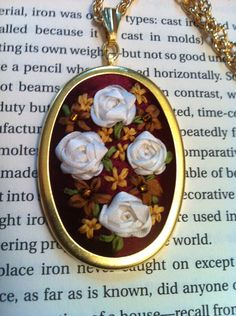 Red, White and Gold Beaded Flower Pendant - Silk Ribbon Embroidery by BeanTown Embroidery. $20.99, via Etsy.