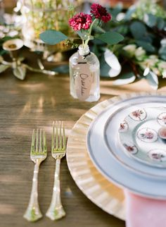 These little bottles could be super cute where u want names for seating...or wedding party