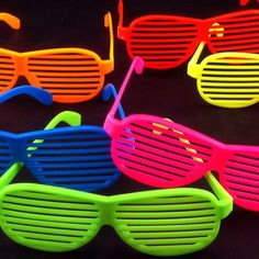 """Have a blast from the past at your next summer party. This set of 12 """"Shutter Shade"""" style sunglasses make awesome party favors for your next 80s party. Assorted colors of purple, blue, pink and green. Fun for adults and children alike ! http://www.amazon.com/gp/customer-media/permalink/mo27TV2F7RO875B/B002C3R5XI/ref=cm_sw_r_pi_ci_B002C3R5XI"""
