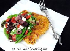 """<p>This classic dish takes on a Mediterranean twist.</p> <p><a href=""""http://www.fortheloveofcooking.net/2012/08/greek-chicken-milanese.html""""><strong>SEE RECIPE HERE:Greek Chicken Milanese</strong></a></p>"""