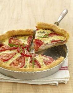 """750g vous propose la recette """"Tarte gourmande à la tomate et au Bresse Bleu"""" notée 4.2/5 par 46 votants."""