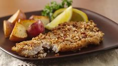 Turn the catch of the day into  delicious dinner in only 25 minutes. Hot pecan-crusted fish fillets are cooked easily on stove top and  are served with lemon wedges.