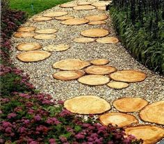Garden path from design accents pebbles bushes wood pretty flowers