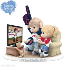 A first ever! Limited-edition officially licensed Precious Moments figurine celebrates the <i>Indians</i>™ and love. Fine bisque porcelain.
