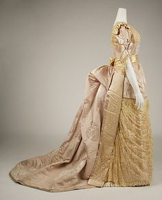 Dress, Evening, side view. House of Worth (French, 1858–1956). Designer: Jean-Philippe Worth (French, 1856–1926). Date: 1887–89. Culture: French. Medium: silk. Dimensions: Length at CB (a): 9 1/4 in. (23.5 cm). Length at CB (b): 60 in. (152.4 cm). Credit Line: Gift of Orme Wilson and R. Thornton Wilson, in memory of their mother, Mrs. Caroline Schermerhorn Astor Wilson, 1949. Accession Number:49.3.24a–e. Metropolitan Museum of Art, NYC, USA.