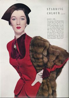 50s Vintage Vogue Magazine Ad features a model in a red dress, mink stole, and veiled hat.