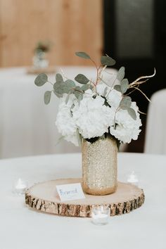 How elegant is this natural wedding table centerpiece? Love the ivory flowers, greenery, gold vase, and stump base. An easy centerpiece that is so gorgeous! Taken at THE SPRINGS in Tulsa. Follow this pin to our website for more information, or to book your free tour! Photographer: Christina Rose Photography #weddingcenterpiece #elegantwedding #weddingdecor #elegantweddingideas #weddingdecorations #elegantweddingdecor #weddingideas #naturalwedding #naturalweddingdecor #weddingreception