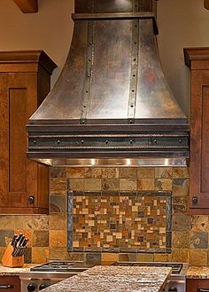 LOVE the hood. Custom bronze range hood, with hand-forged steel detailing. love the hood, not the kitchen it's in. Kitchen Hood Design, Kitchen Vent Hood, Kitchen Stove, Kitchen Hutch, Kitchen Layout, Kitchen Designs, Oven Hood, Oven Vent, Oven Range