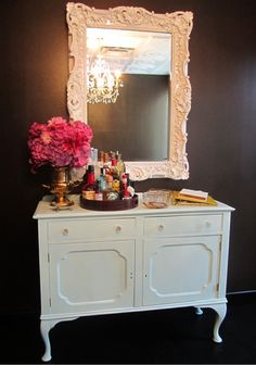 White vintage Chest and mirror on grey wall