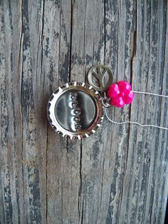 """""""Bloom"""" punched pop cap necklace with flower charm and peace sign--hand crafted"""