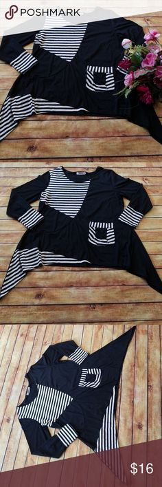 🌹New Listing🌹Black Tunic w/White Stripes, Xin YI Boutique Tunic by Xin YI. Black sharkbite hem with white stripe accents. So cute!! 3XL but this runs small. See measurements, would fit 2X, 1X comfortably. This was too snug on my stomach area. EUC! Xin YI Tops Tunics