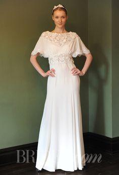 "Brides.com: Temperley Bridal - Spring 2014. ""Peony"" sheath wedding dress with high neckline, short sleeves, and floral applique details on neckline and waist, Temperley Bridal"