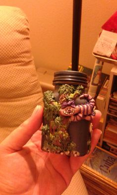 Cheshire done in sculpey clay on glass jar