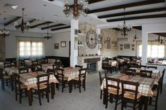 10 ταβέρνες με τζάκι και καλό φαΐ   TimeOut Cyprus Cyprus, Conference Room, Table, Furniture, Home Decor, Decoration Home, Room Decor, Tables, Home Furnishings