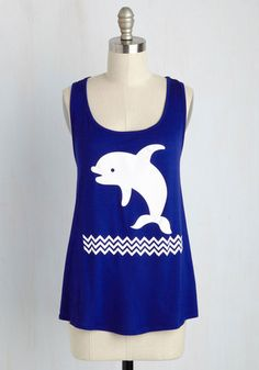 Vacation means a new locale and new friends to follow, which this cobalt tank top will garner quite quickly! A true conversation starter, this jersey knit garment offers a ModCloth-exclusive graphic of a playful white dolphin leaping over chevron waves to your hunt for pals with a quirky proclivity.