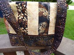 Really like the colors and the batik fabric in this purse/handbag. Has a long strap so can carry over your shoulder and BIG enough to hold all your stuff.
