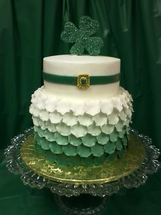 Birthday cake for 3 special ladies. Margarita cake with key lime cream cheese filling and frosted in buttercream. Fondant ruffles and gumpaste brooch and shamrock.