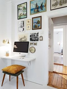 One of our favorite space-saving tricks for a small apartment is the wall-mounted desk. A wall-mounted desk is an easy way to add a work area that takes up a fraction of the space occupied by a traditional floor-bound desk — and it results in a lot less visual clutter, too, a consideration nearly as important as floor space. Some desks even fold into the wall so they take up no space at all. We've rounded up a few of our favorites.
