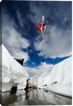 Skier jumping over creek at Oppdal Ski Resort. print by Christian Aslund at Photos.com 148533090